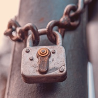 Lock and chain locked around a pole - 'Trusting Standards'